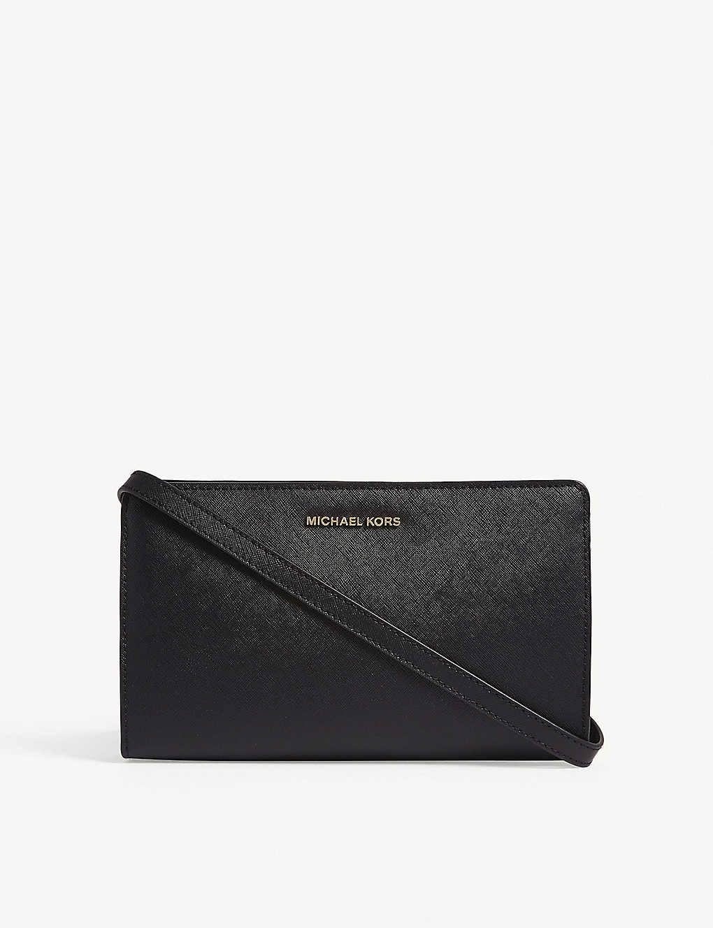 2ebaaff25c1 MICHAEL MICHAEL KORS - Jet Set Travel leather clutch | Selfridges.com
