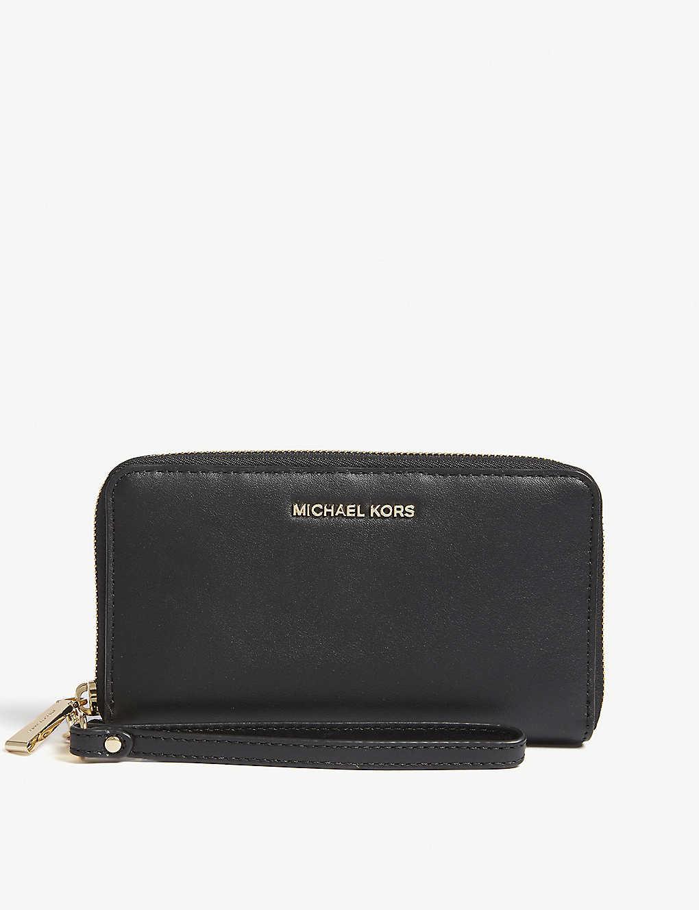 3c58f7a2e09359 MICHAEL MICHAEL KORS - Wristlets leather phone purse | Selfridges.com