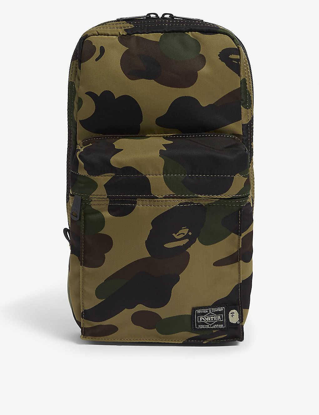4ed2551f7 A BATHING APE - Porter camouflage-print sling bag | Selfridges.com