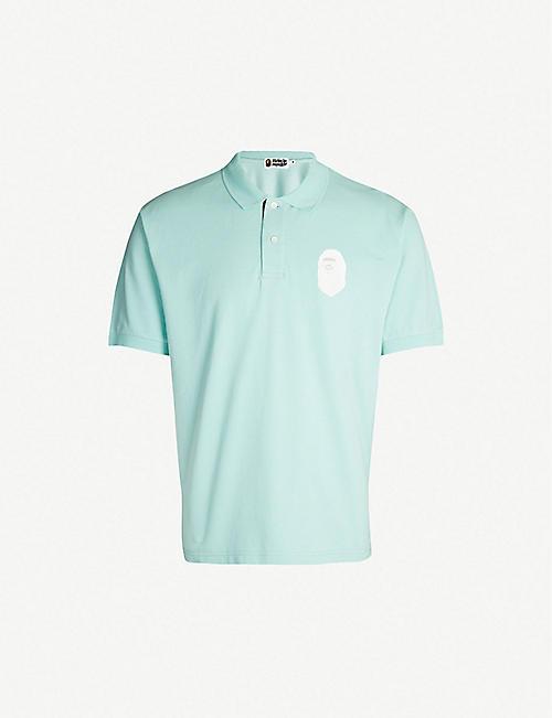 f94a024f84fd A BATHING APE Logo-appliquéd oversized cotton-piqué polo shirt