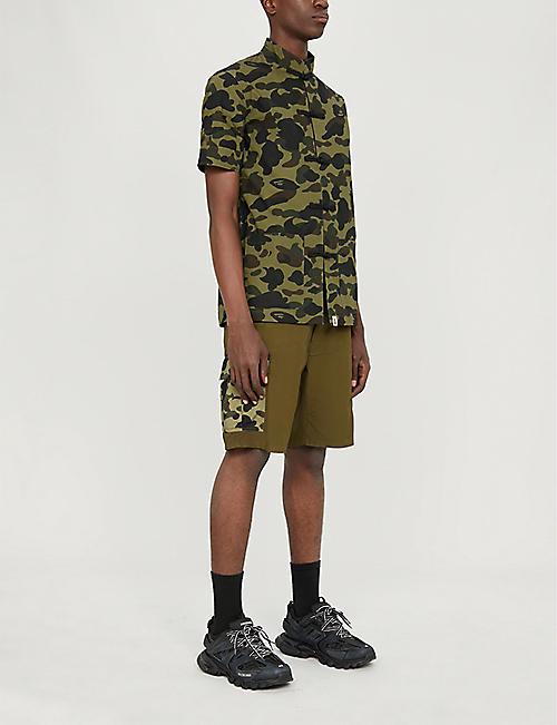 56b3a44df2 A BATHING APE Camouflage-print cotton-jersey shirt. Quick Shop