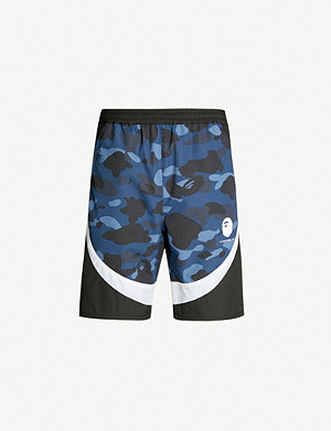 A BATHING APE Camouflage-print shell shorts