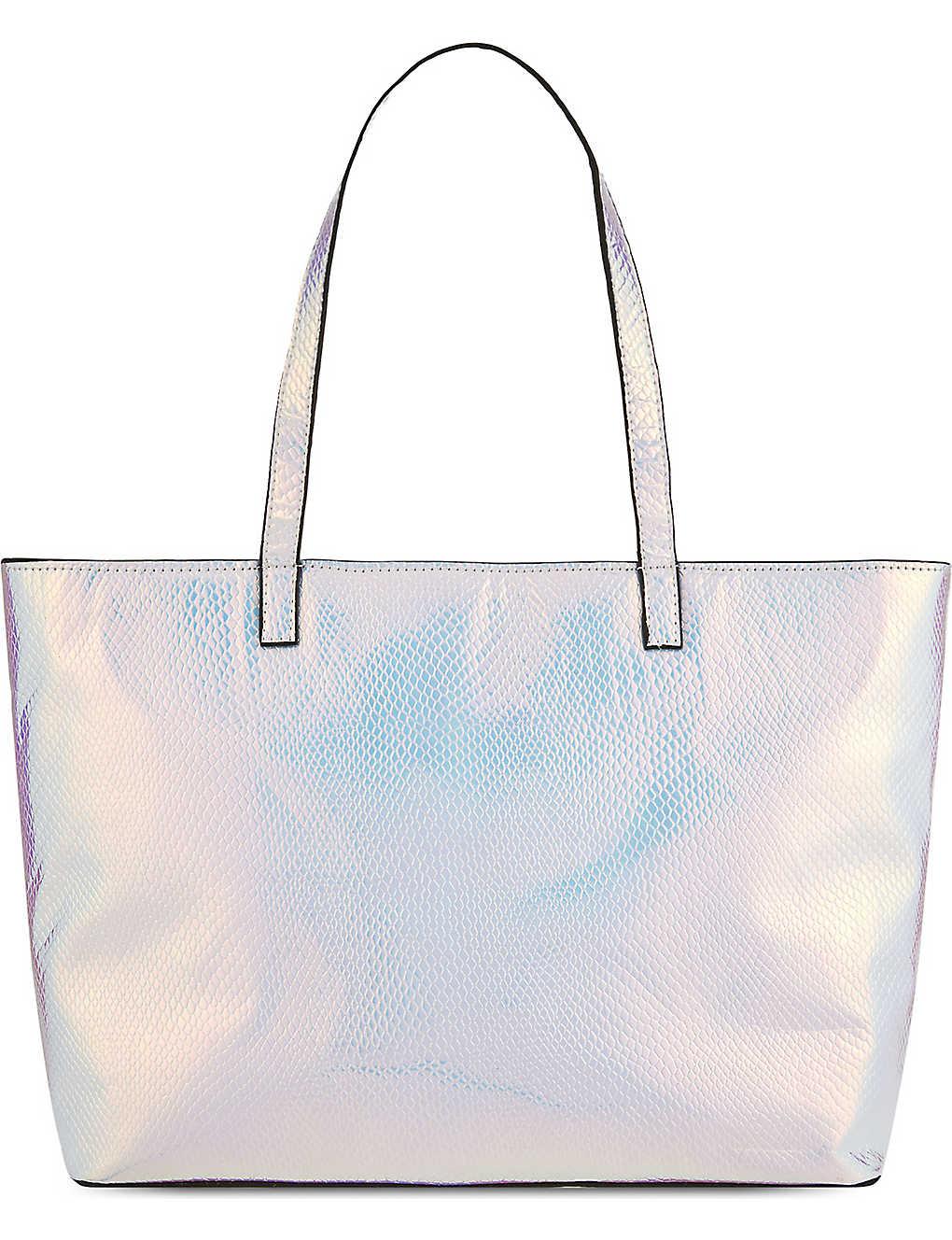 b5a2290b7 SKINNYDIP - Cosmo silver bag   Selfridges.com