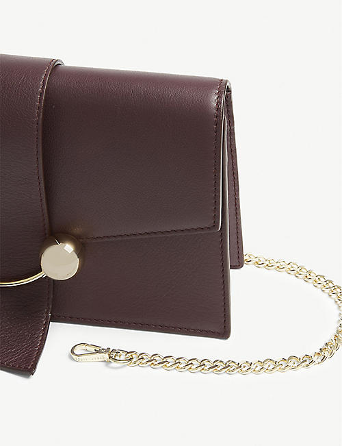 STRATHBERRY Leather mini crescent clutch bag