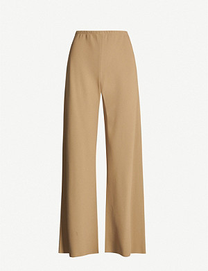 THE ROW Gala mid-rise flared crepe trousers