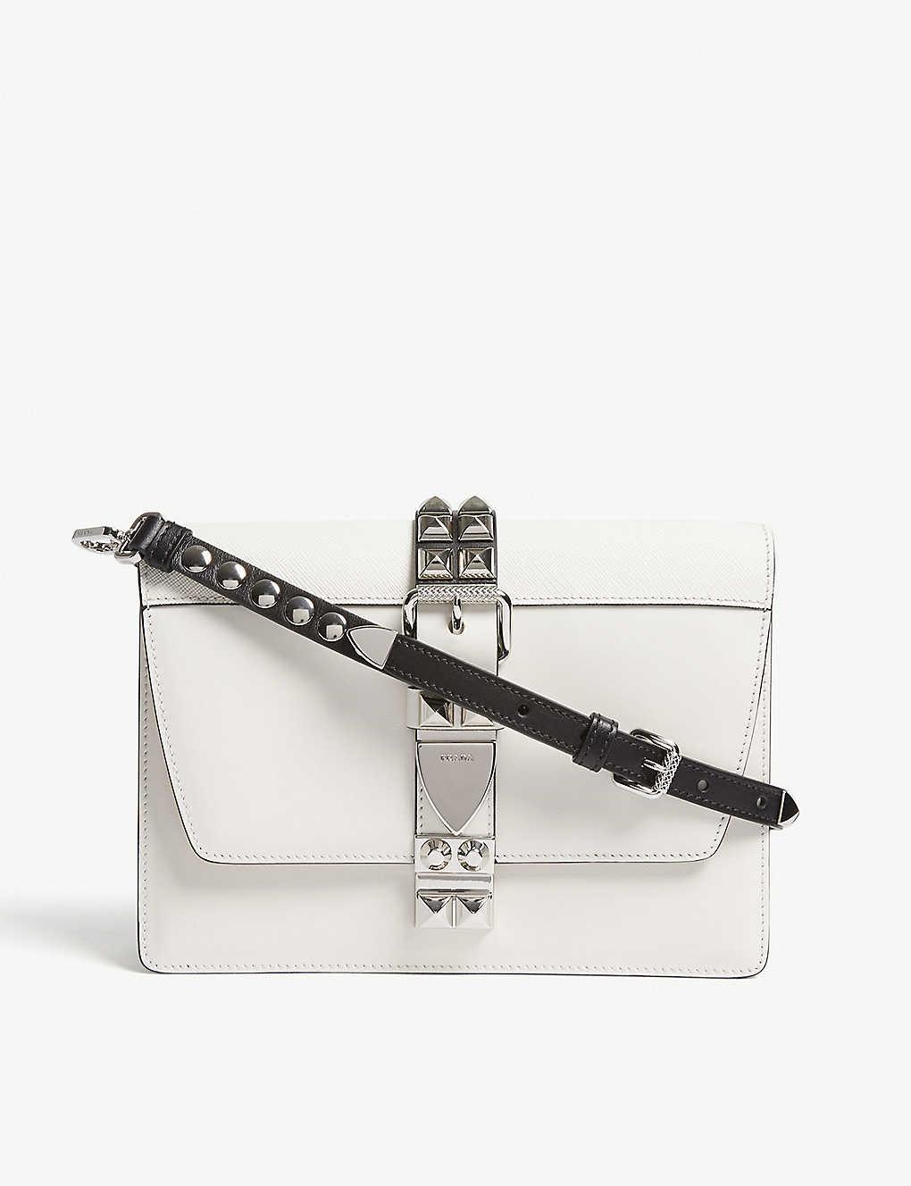 1607dfb57259 PRADA - Elektra studded leather shoulder bag | Selfridges.com