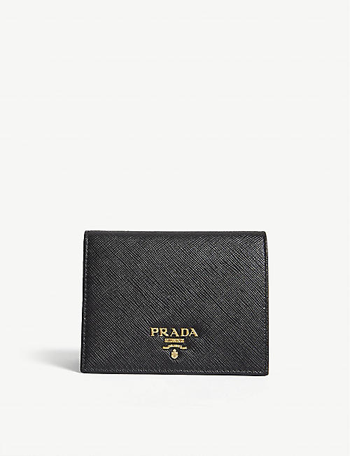 8c984a254a PRADA - Logo small Saffiano leather purse | Selfridges.com