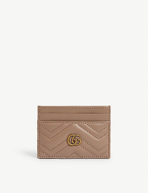 GUCCI: Logo quilted leather card holder