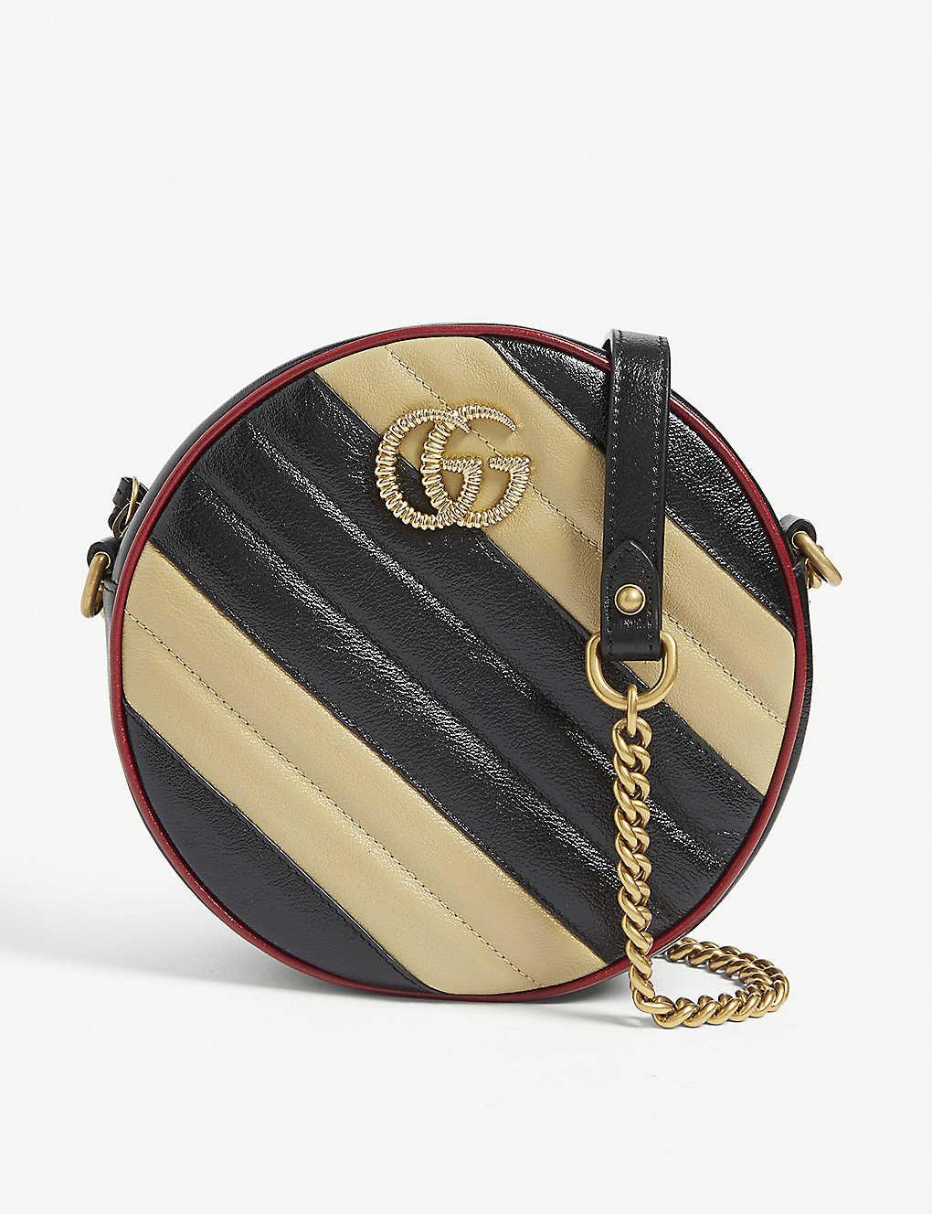 de7aa9734 GG Marmont mini leather shoulder bag - Nero diagonal beige ...