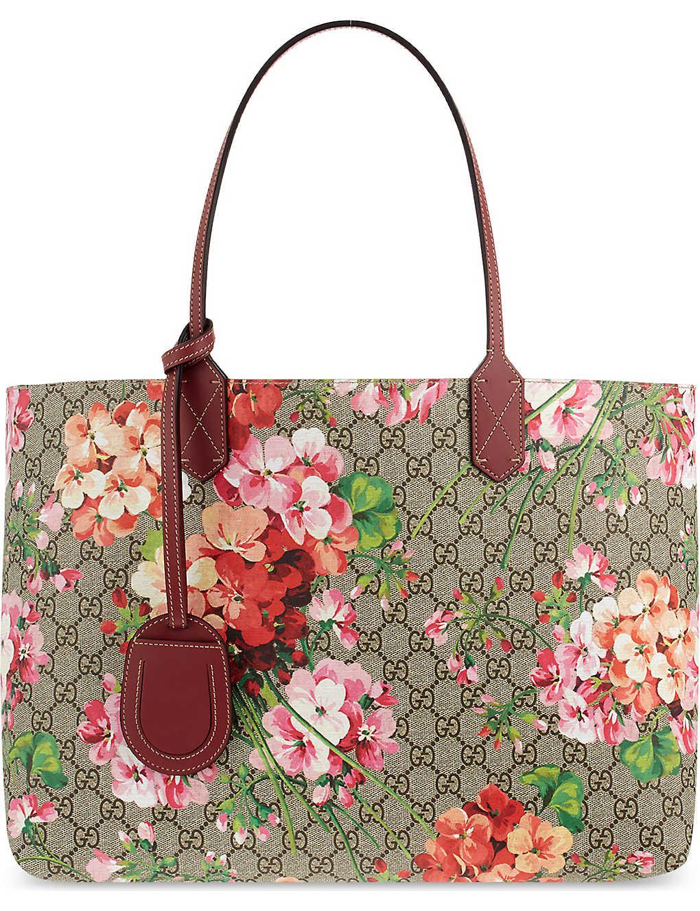 57ed59b8ced4 GUCCI - Reversible floral logo leather shopper bag