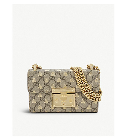 f506b945d48a GUCCI Small GG Supreme canvas and leather bee motif cross-body bag (Beige