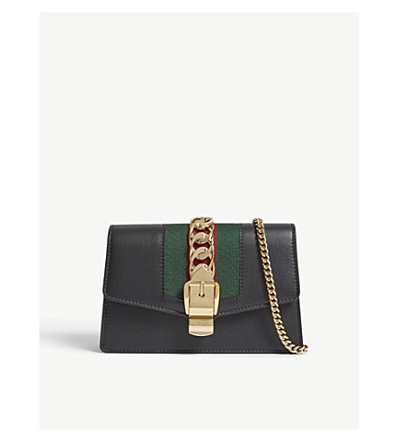 ... GUCCI Sylvie Supermini leather cross-body bag (Black. PreviousNext b72a6446c9bf3