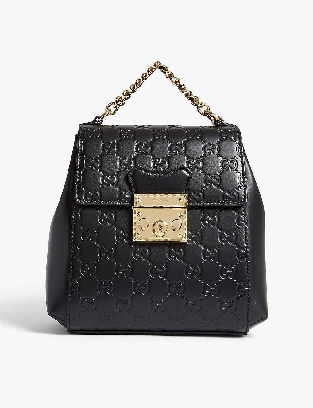 26cc72472a55 GUCCI - GG padlock leather backpack | Selfridges.com