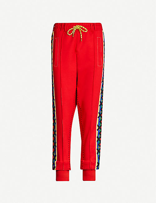 PUMA X JAHNKOY Stripe-trimmed mid-rise stretch-jersey jogging bottoms