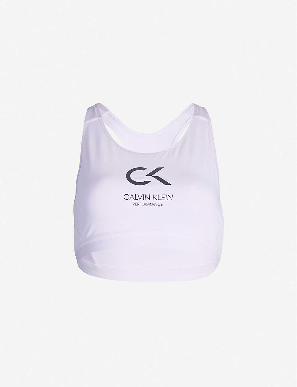 77fe22dee289 CALVIN KLEIN - Performance logo-print sports bra | Selfridges.com