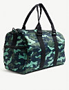 3e40ef4120b PUMA - PUMA x Sue Tsai floral-embroidered holdall | Selfridges.com
