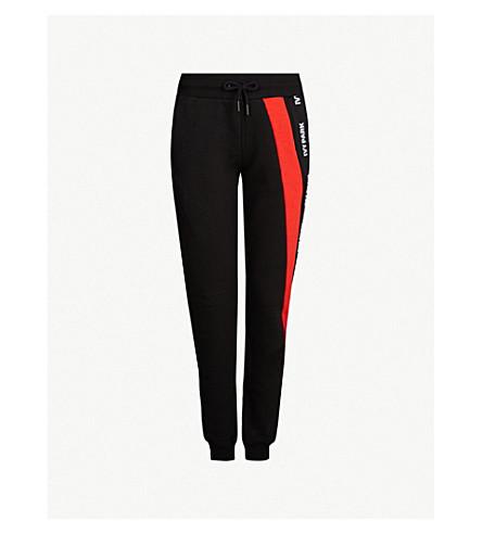 0d79cf31f270 IVY PARK - Asymmetric logo-tape cotton-jersey jogging bottoms ...