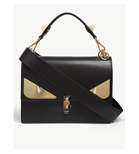 6b7d87c626f9 ... FENDI Kan I monster leather shoulder bag (Black gold. PreviousNext