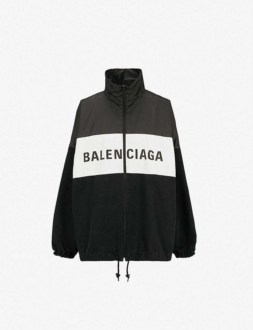67601f9f7db2 BALENCIAGA - Logo-print nylon and denim jacket | Selfridges.com