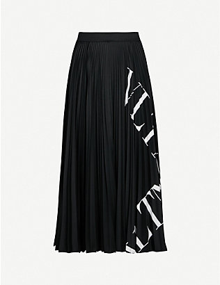 VALENTINO: Logo-print pleated stretch-jersey midi skirt