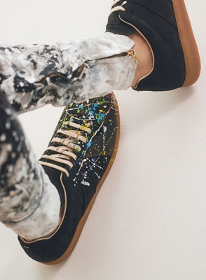 An image of paint-splattered shoes and jeans