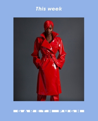 A woman wearing a red Gareth Pugh mac