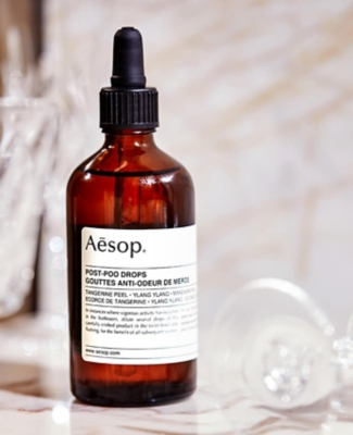 A bottle of Aesop post poo drops on a table