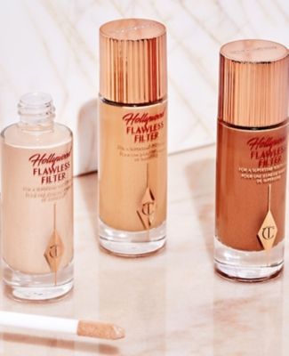 Three bottles of Charlotte tilbury Hollywood flawless filter foundation on a table