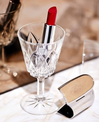 Guerlain Rouge lipstick in a wine glass