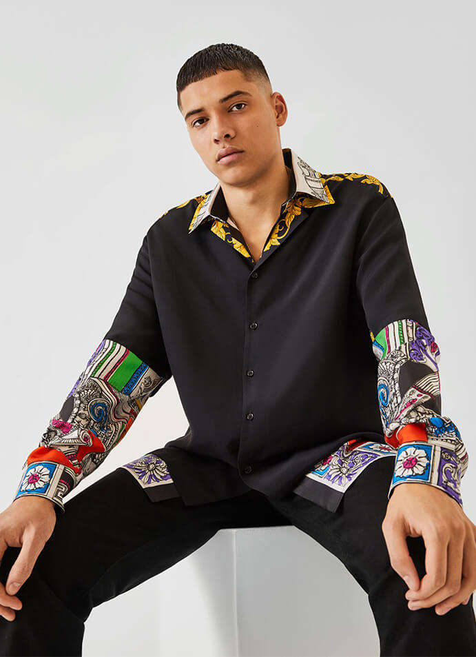 The model is wearing a Gucci Jacket, trousers and shoes.