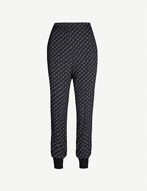 STELLA MCCARTNEY Julia loose-fit tapered stretch-crepe trousers