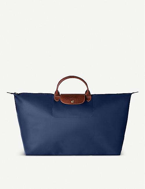 LONGCHAMP - Le Pliage large travel bag in navy  7dc2cd45ce4ee