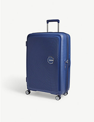 AMERICAN TOURISTER: Soundbox expandable four-wheel suitcase 77cm