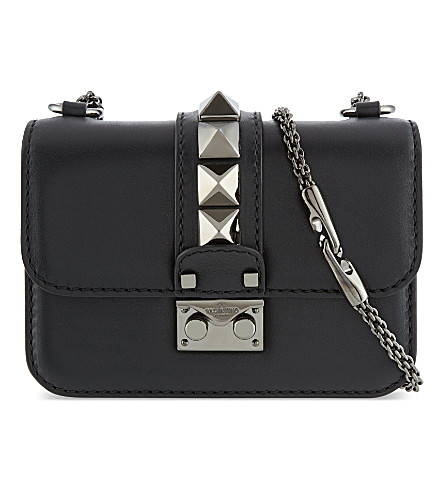 25c537ff0645 VALENTINO - Noir mini studded shoulder bag