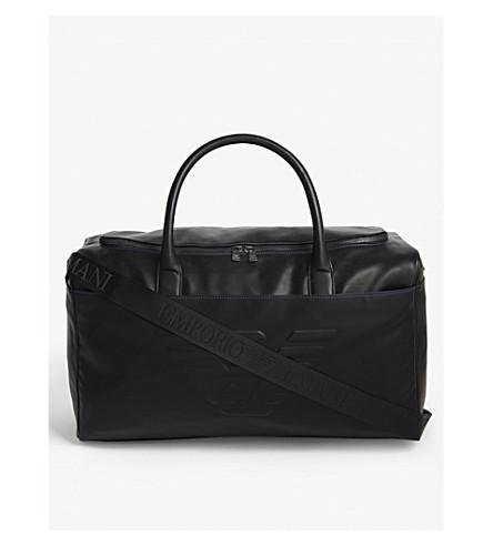 ... EMPORIO ARMANI Embossed logo leather holdall bag (Black. PreviousNext 8e01157300ed4