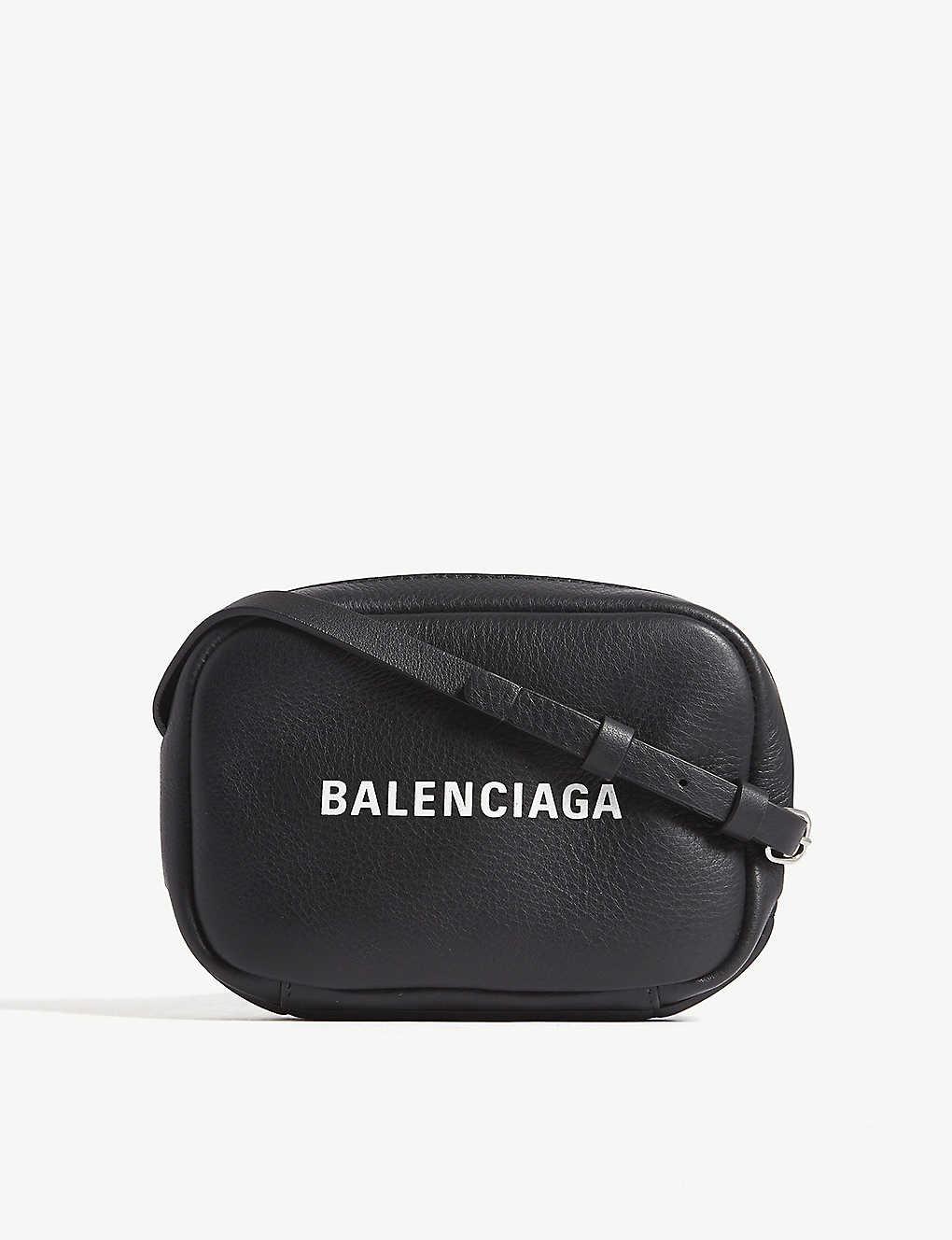 0f1ba617c BALENCIAGA - Logo-print leather camera cross-body bag   Selfridges.com