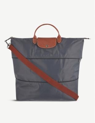 03aaf7a80 LONGCHAMP - Le Pliage travel bag | Selfridges.com