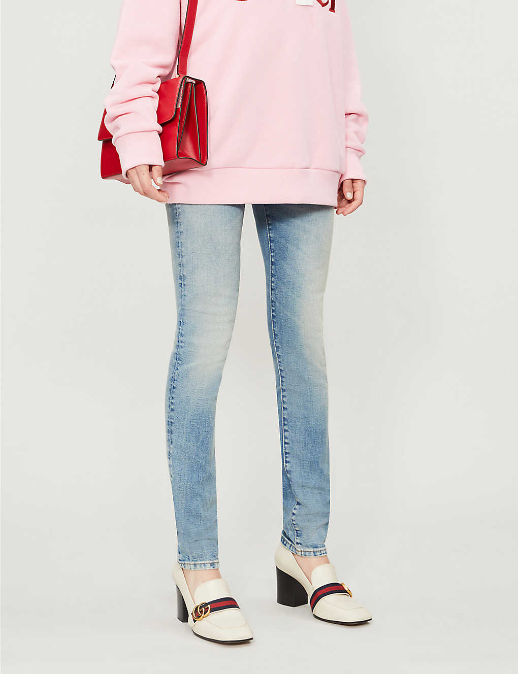 GUCCI: Patch-embroidered skinny mid-rise jeans