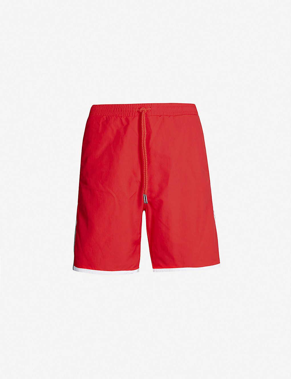 ba2d5b30cd TOMMY JEANS - Tommy x Coca Cola cotton shorts | Selfridges.com
