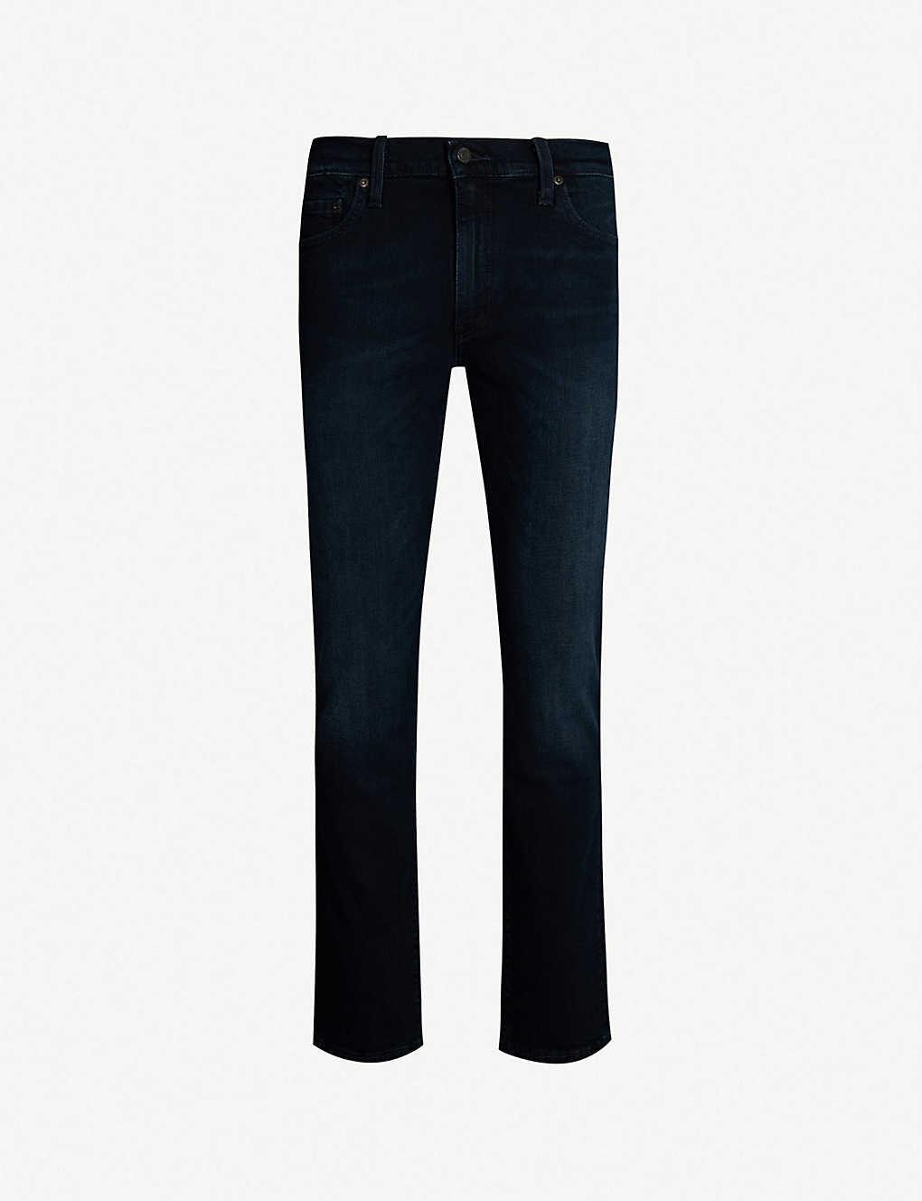1ba700fd11a LEVI'S - 511 slim-fit straight-leg jeans | Selfridges.com