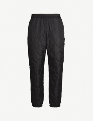 STUSSY Relaxed-fit quilted trousers