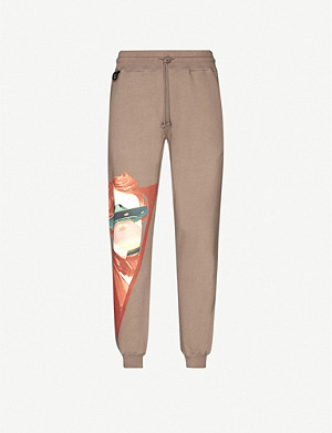 UNDERCOVER Face-print cotton-jersey jogging bottoms