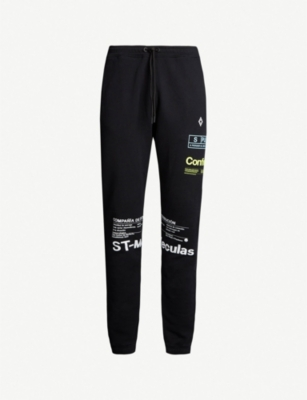 MARCELO BURLON Text-print cotton-jersey jogging bottoms