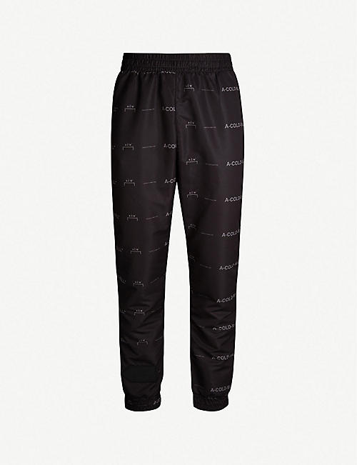 A-COLD-WALL Logo-print relaxed-fit tapered shell jogging bottoms