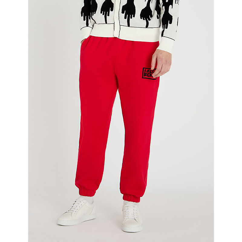 LIFES A BEACH Logo-Print Cotton-Jersey Jogging Bottoms in Red