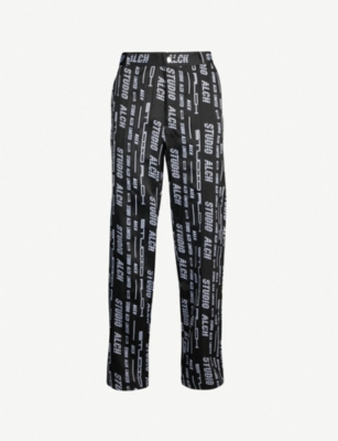 STUDIO ALCH Logo-print regular-fit tapered drill trousers
