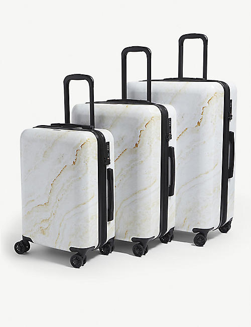 CALPAK Gold Marble four-wheel suitcases set of three