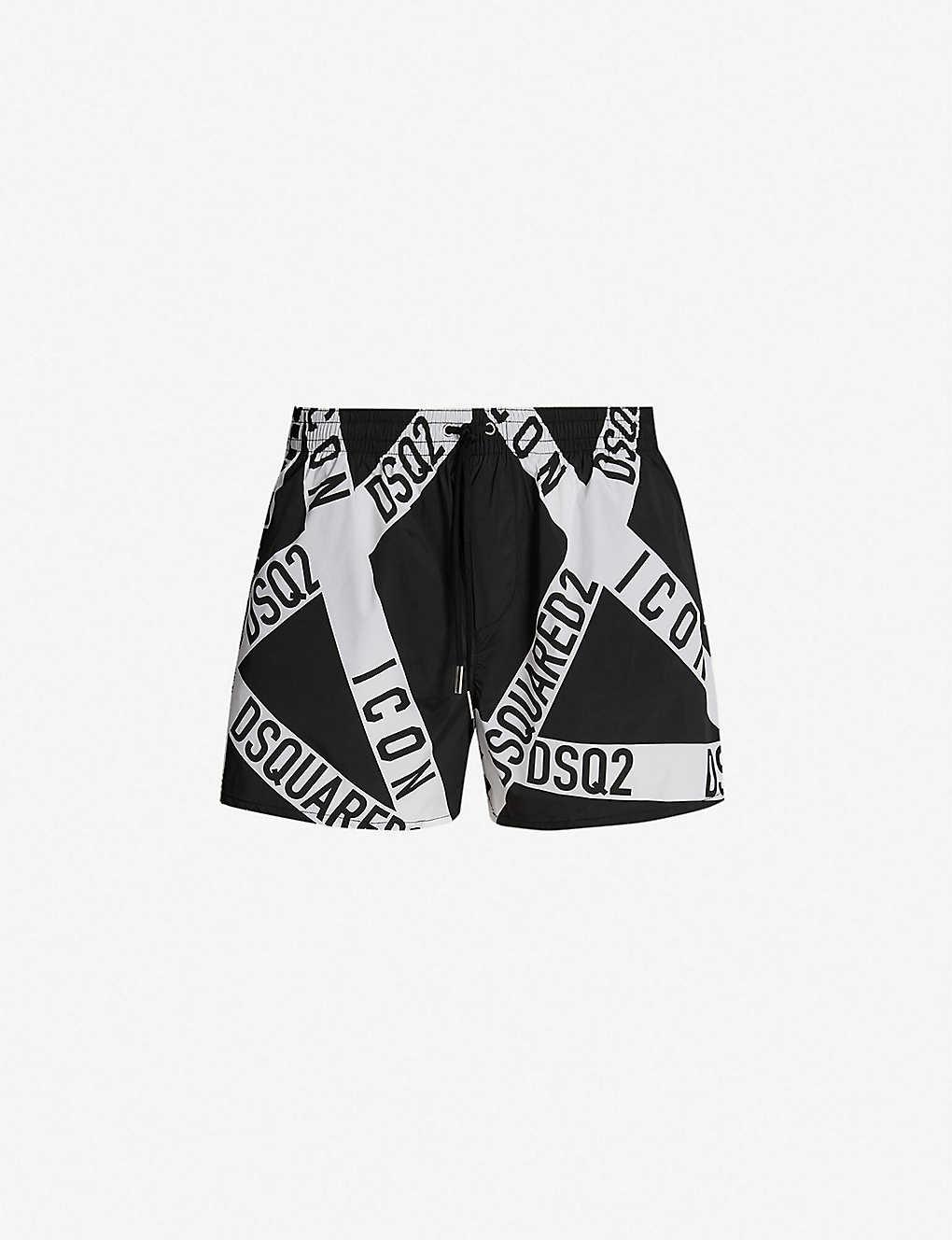 aed6e28e02 DSQUARED2 - Relaxed-fit firetape print swim shorts | Selfridges.com