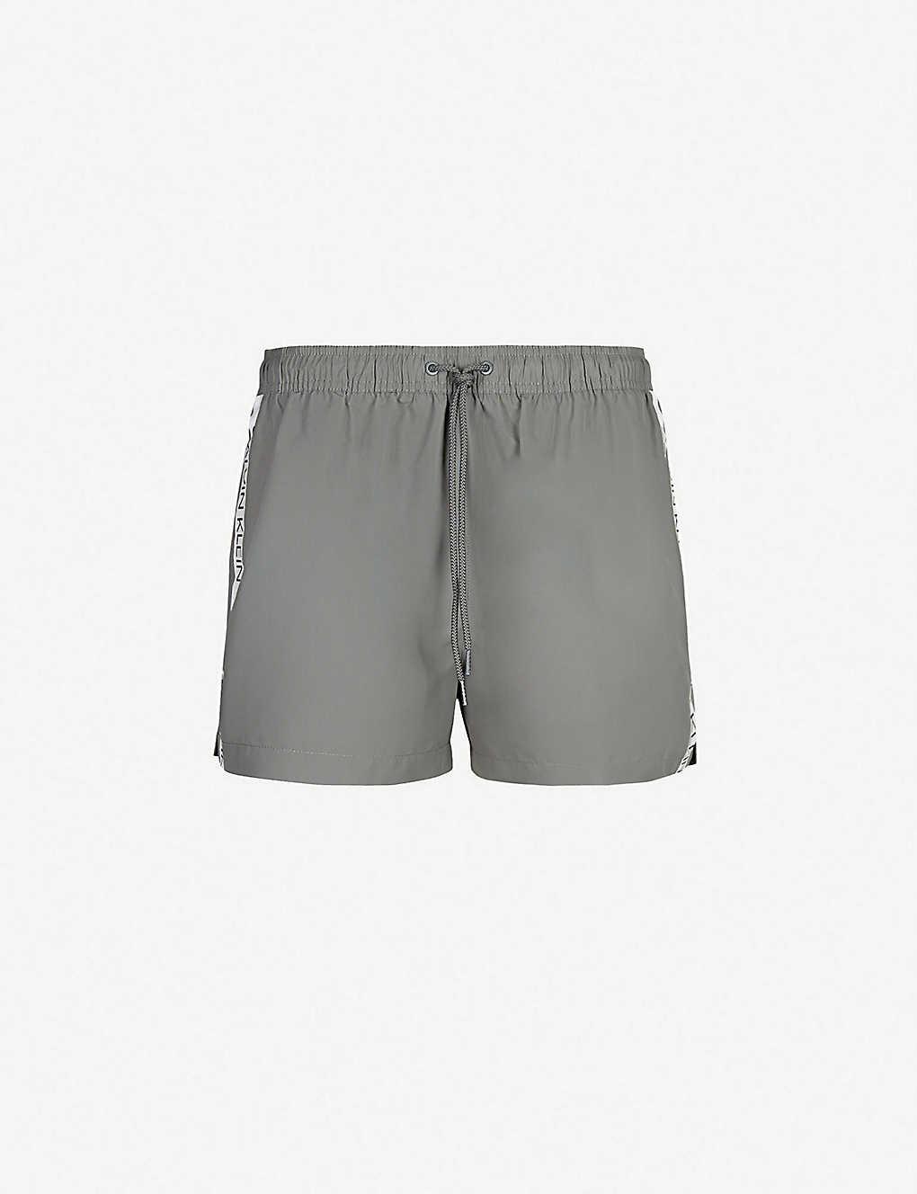 c011cd97d4 CALVIN KLEIN - Side-stripe logo-print swim shorts   Selfridges.com