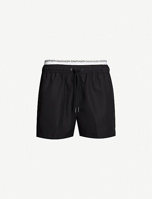 a22e623527941 CALVIN KLEIN Logo-waist mesh-lined drawstring swim shorts